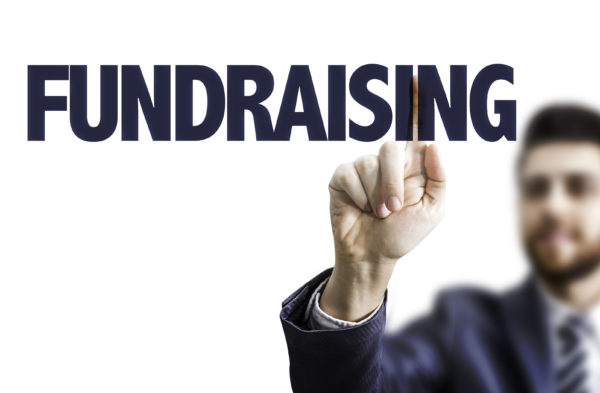 Business man pointing the text: Fundraising